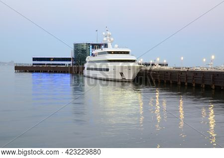 The Pleasure Boat Is Moored To The Pier On Baku Boulevard In The Evening