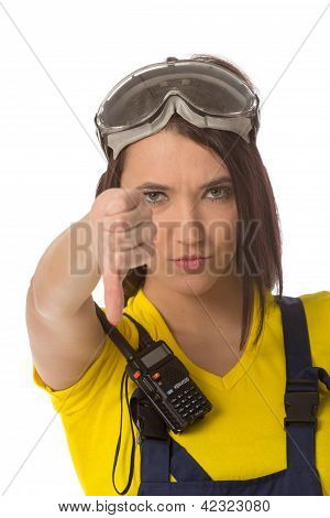 A female construction worker holding a down signal - isolated. poster