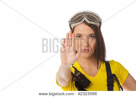 A female construction worker holding a stop signal - isolated. poster
