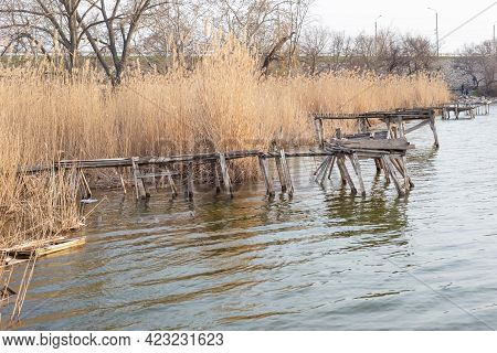 A Beautiful Shot Of A Berth Surrounded By Water Grassold Fishing Masonry On The River In The Reeds