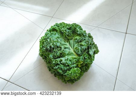 Kale On A Cutting Board, On The Table Top. Superfood And The Rays Of The Sun