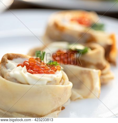 Delicate Crepes For Breakfast. Close Up Shot. Expensive Thin Pancakes Decorated With Cream And Red C