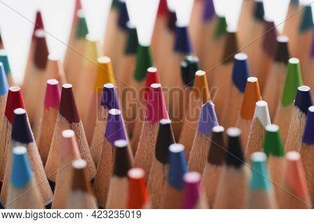 Closeup Of Many Sharp Multicolored Wooden Pencils Background