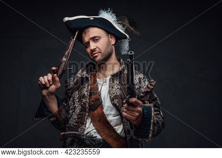 Cool Pirate With Handguns Against Dark Background