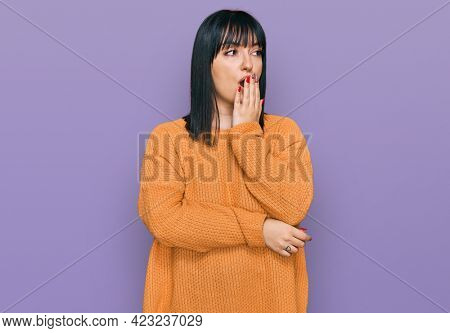 Young hispanic woman wearing casual clothes bored yawning tired covering mouth with hand. restless and sleepiness.