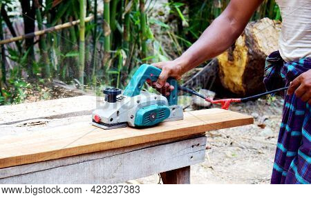 Man Planed Board Electrical Plane. Construction, Wood Processing