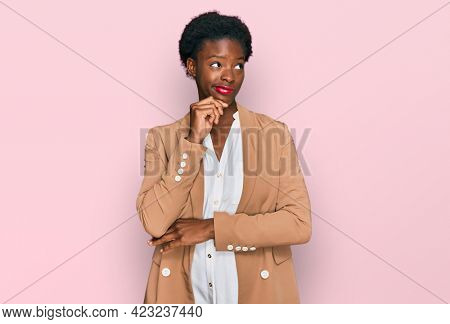 Young african american girl wearing business clothes serious face thinking about question with hand on chin, thoughtful about confusing idea