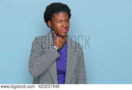 Young african american girl wearing casual clothes touching painful neck, sore throat for flu, clod and infection