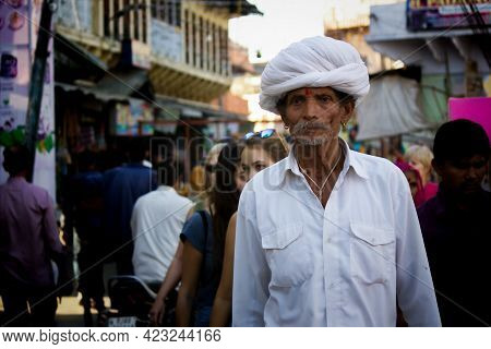 Pushkar, India - November 10, 2016: An Old Rajasthani Man In Traditional Ethnic Wear Such As White T