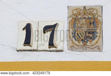 Seville, Spain - Sept 27th 2020: Royal Alcazars Of Seville. Coat Of Arms Glazed Tiled And 17 Door Nu