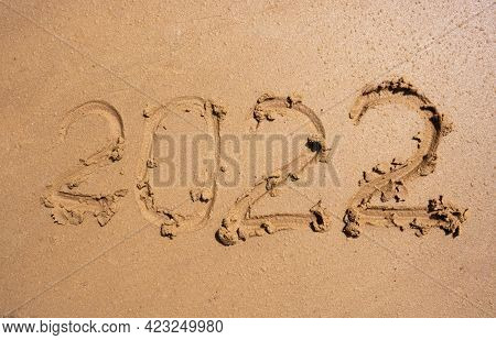 The Numbers 2022 On The Wet Sand. The Concept Of The New Year 2022. Summer Holidays And Sea Trips.