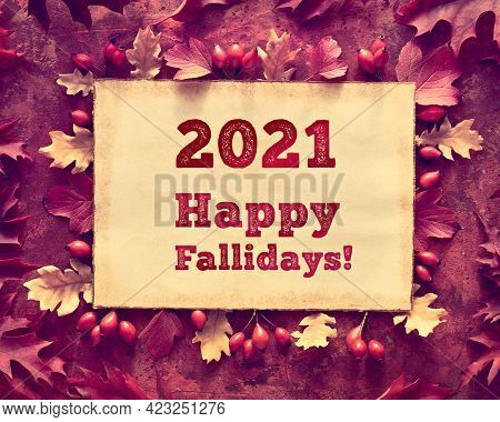 Text 2021 Happy Fallidays On Aged Paper, Parchment. Autumn Leaves, Flat Lay In Red And Purple Tones