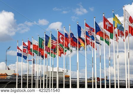 Flags Of The World Waving Against The Background Of A Cloudy Sky. Flags Of The Countries Of The Worl