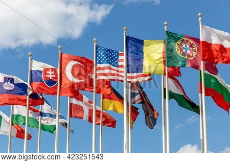 Group Of Flags Of Various States - As A Symbol Of World Cooperation. Flags Of The Countries Of The W