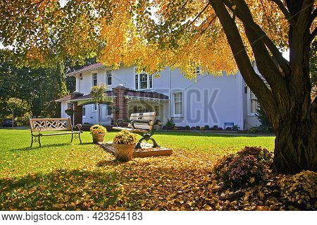 Wooden Benches In The Front Yard Of A House In Toronto, Ontario, Canada