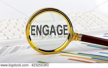 Magnifying Glass With The Word Engage On Chart Background