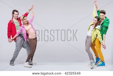 Two young couples dancing