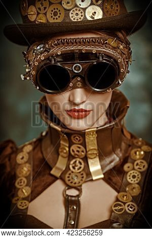 Fantasy world, scientific inventions. Close-up portrait of a beautiful victorian steampunk lady on a vintage  background.
