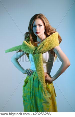 Romantic summer style. Beautiful fashion model girl poses in stylish summer clothes. Studio portrait. Fashion shot.