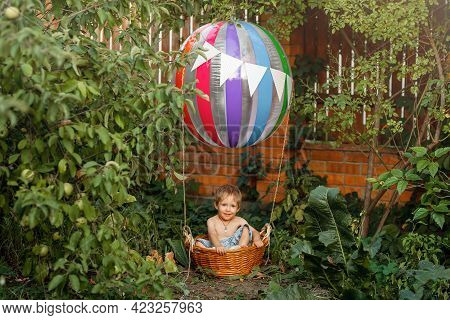 Freedom And Happy Childhood Concept. The Toy Air Balloon For Child. Hot Air Balloon. Cute Child On A