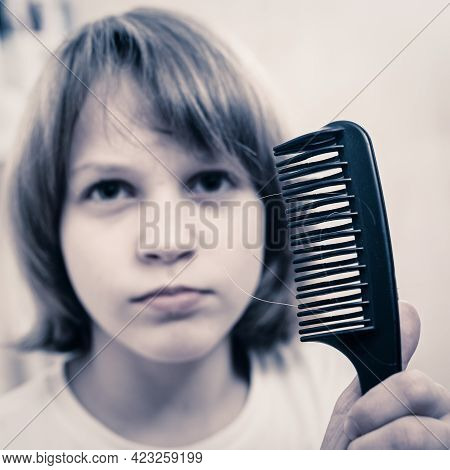 Portrait Of Young Boy In Bathroom Combing Hair In The Morning, Focus On Comb Foreground, Its Hard To