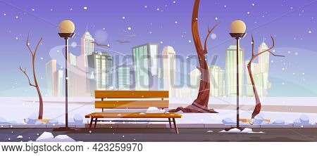 Winter City Park With Wooden Bench, Bare Trees, Blizzard And Snowdrifts Around, Lanterns And Town Bu