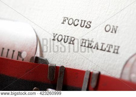 Focus on your heath phrase written with a typewriter.