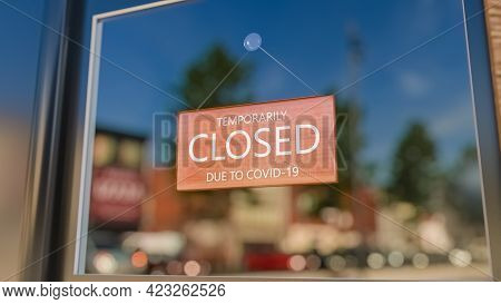 Closed Sign On Shop Window. Store Sign. Close-up On A Closed Sign In The Window Of A Shop Displaying