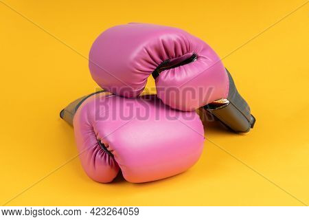 Pair Of Pink Boxing Gloves On Yellow Background