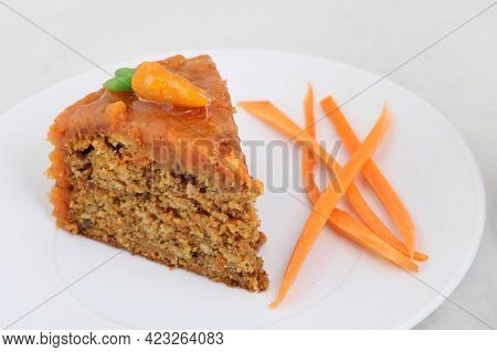One Piece Of Carrot Cake On White Plate