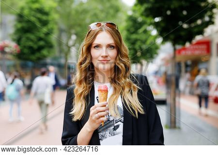 Young Business Woman Eating Ice Cream. Happy Alone Woman In In The City On Sunny Summer Day, Break F