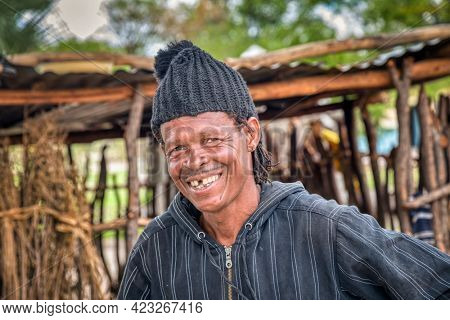 Smiling African man portrait standing in his yard in a village in Botswana