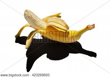 Ripe Yellow Peeled Banana Isolated On A White Background. Hard Dark Shadows From The Sun At Noon