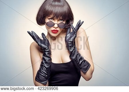 Young Beauty Poses With Gloves And Sun Glasses