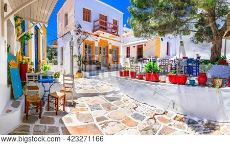 Beautiful Lefkes traditional greek village in Paros island. Charming coffe bars and taverns in colorful narrow streets. Cyclades , Greece