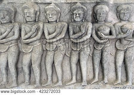 Detail Of Carvings Stone Bas-relief Of Khmer Culture In Thailand, Depicting Khmer Soldier.