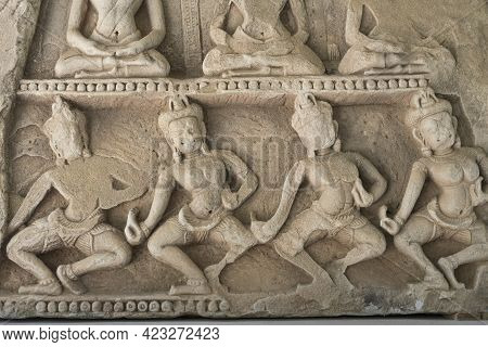 Detail Of Carvings Stone Bas-relief Depicting Apsara Of Khmer Culture In Thailand