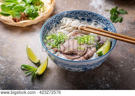 Rice Noodles Soup With Beef And Herbs Or Vietnamese Pho Bo, Close View