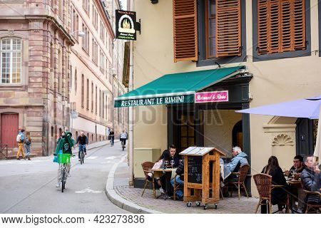 Strasbourg, France - May 19, 2021: Side View Of Young People Eating Drinking At The Terrace Of Le Ri