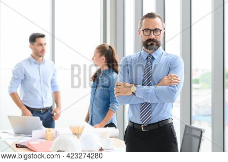 Construction Engineer Manager Standing In Front Of Engineers Team Meeting For Architectural Project