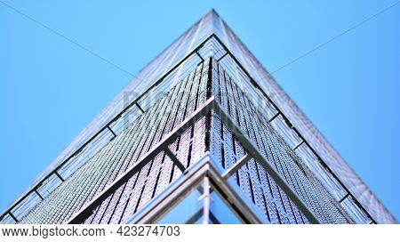 A Fragment Of The Steel And Glass Facade Of Office Building.  Modern Architecture Building Facade. D