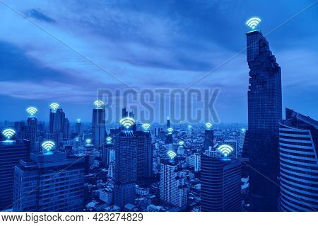 Aerial View Of Modern Cityscape With Wifi Icons, Technology For Smart City. Wireless Communication.