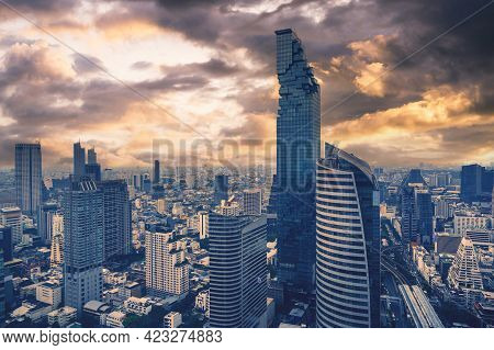 Aerial View Of Bangkok City At Twilight Sunset In Thailand. Cityscape Of Modern Buildings And Urban