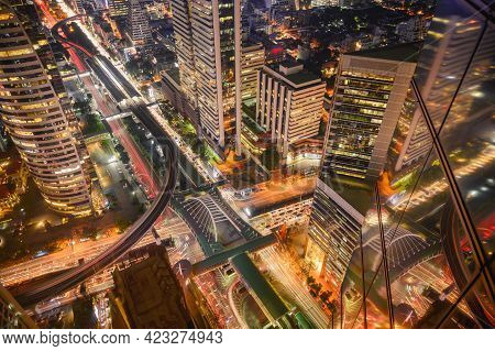 Aerial View Of Bangkok City At Night In Thailand. Cityscape Of Modern Buildings, Urban Architecture
