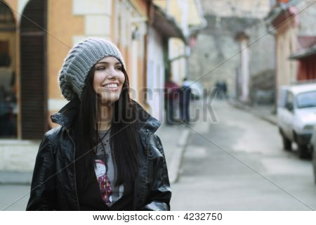 Attractive Girl Smiling On City Streets