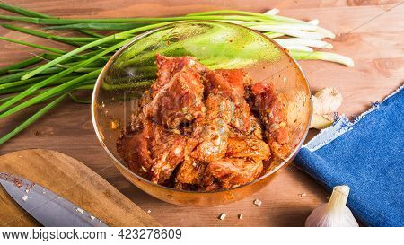 Cooking Chinese Food Pork. Chopped Pieces Of Pork With Sichuan Pepper Sauce, Chopped Ginger And Garl