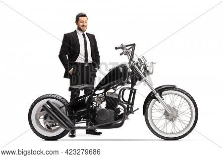 Businessman checking a chopper motorbike willing to buy isolated on white background