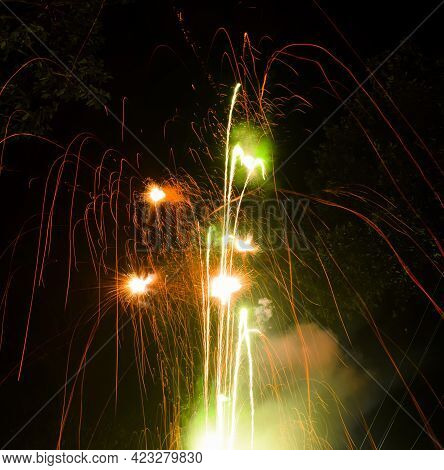 Fireworks With Various Colors During Evening Time On Diwali Festival Celebration. Used Long Exposure