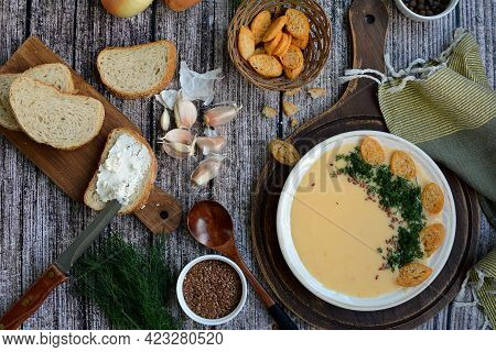 Creamy Potato Soup With Cheese, Croutons And Herbs. View From Above.