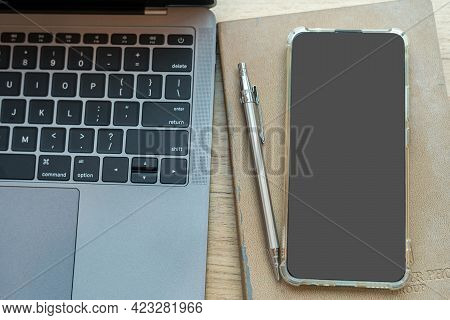Keyboard Laptop Computer,smartphone On Notebook,mechanical Pencil And Coffee Cup On Wooden Backgroun